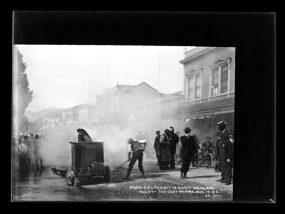 Great Excitement in Hardy St. Nelson. The City Tar Cart on Fire. Mar.18.1912.