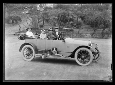 Family with motor car