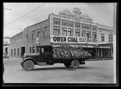 J Baird, shop front, and truck loaded with coal