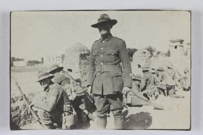 Part of the Nelson Coy. practising street fighting, Zeitoun. S.M. Glanville in foreground.