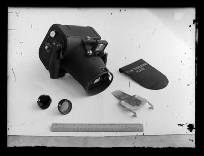 Camera with film threading plate